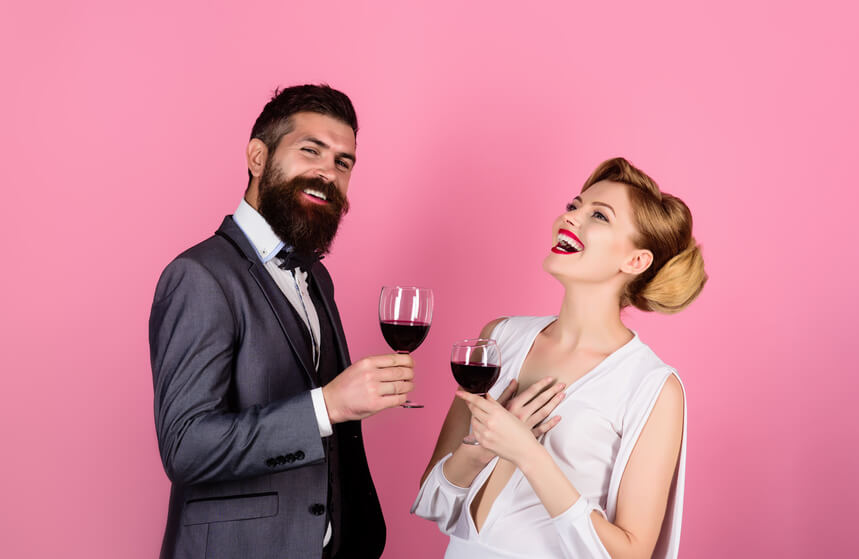 Couple smiling wiht a cup of wine