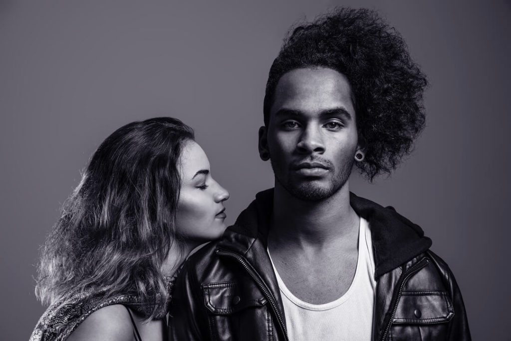 handsome interracial couple. black and white photo