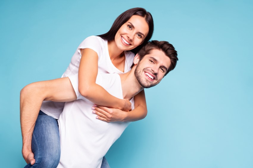 Happy couple in front of a blue background