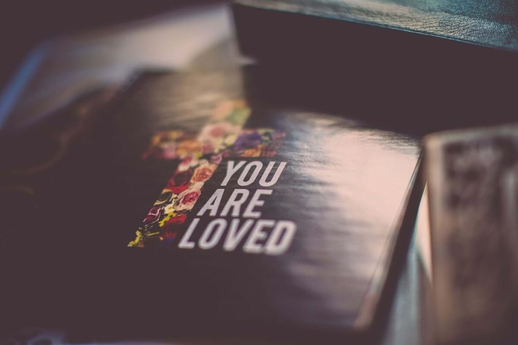 Religious book that says 'You are Loved' on the cover