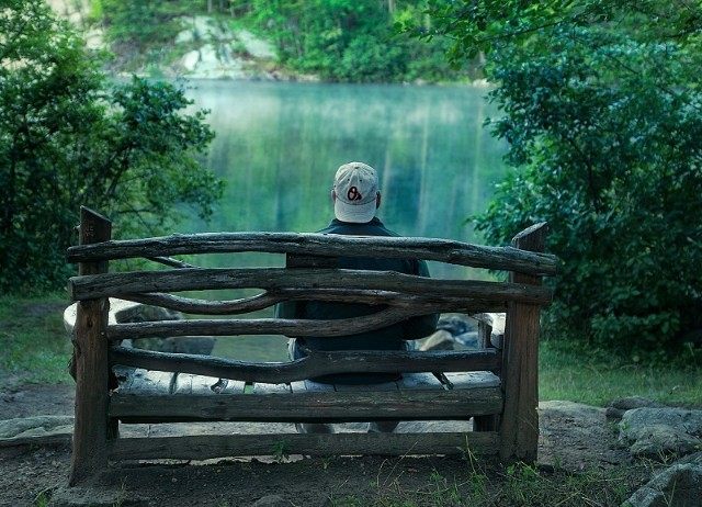 Single man on a bench waiting