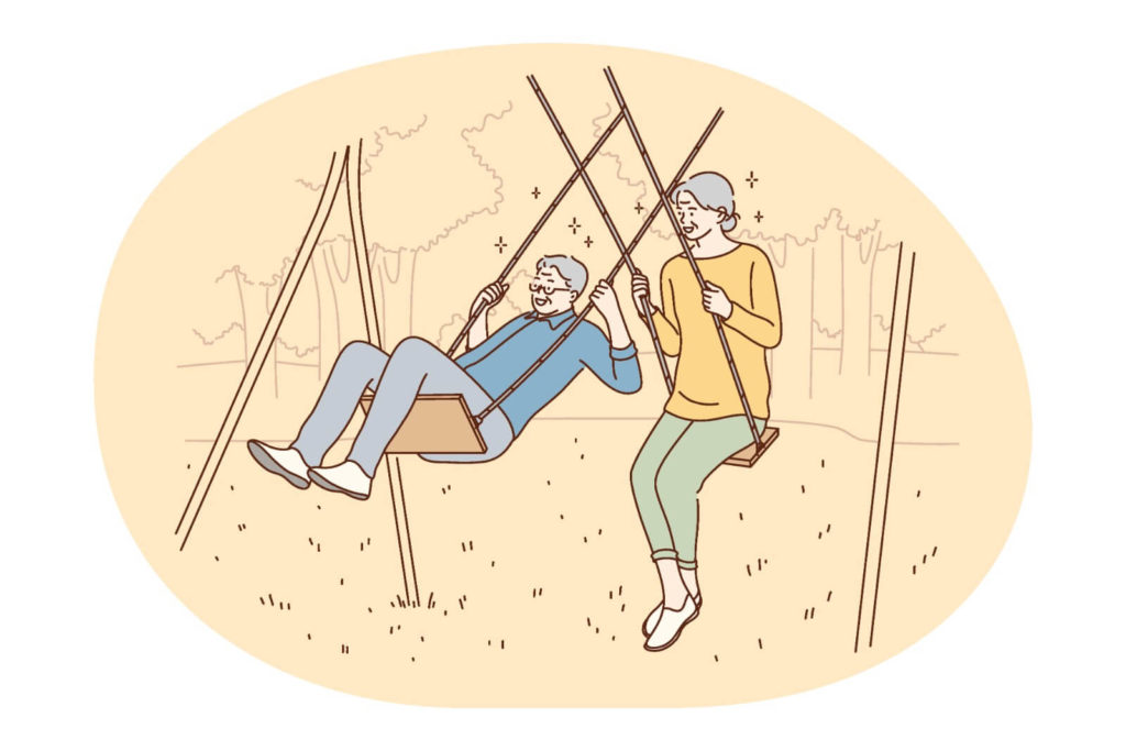 over 60 couple plays on a swing