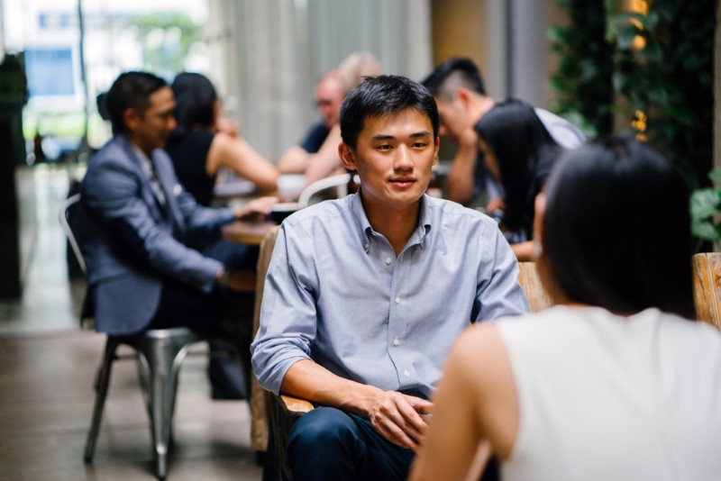 Asian guy in a cafe with his bumble date